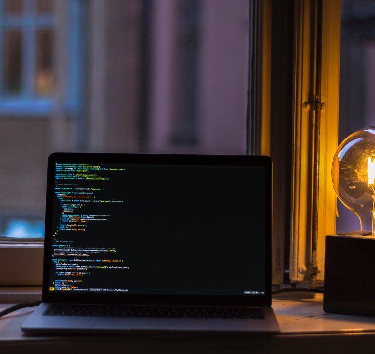 a computer screen in a dark room