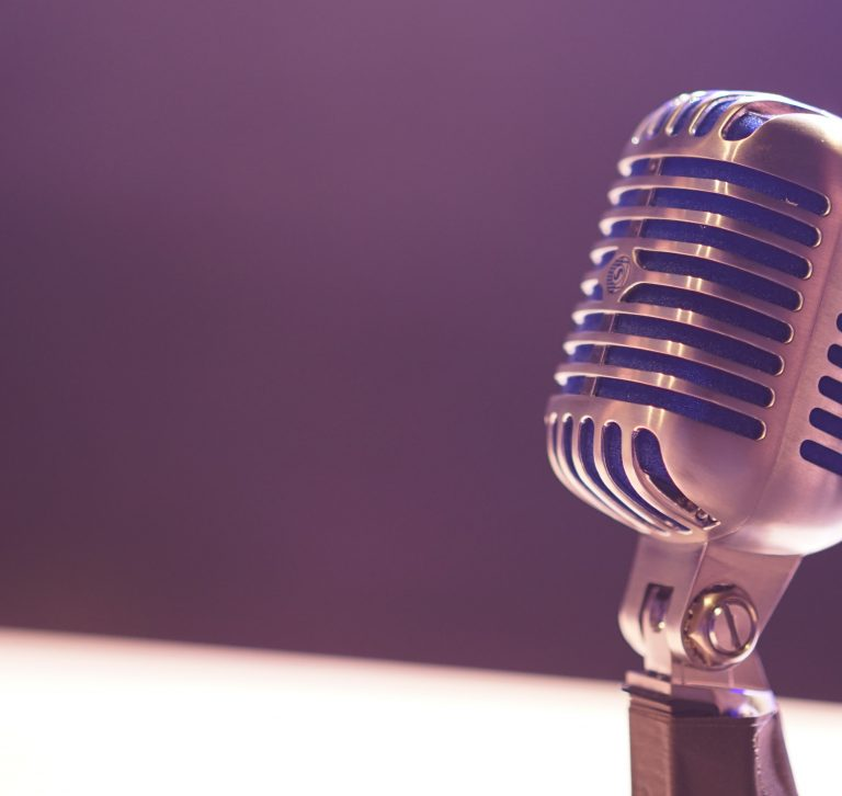 a microphone on a purple background