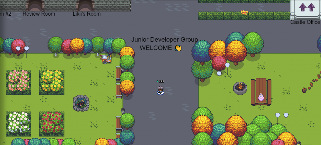 Junior developer group gather map, displaying colourful trees, a firepit and a bench in 2d world